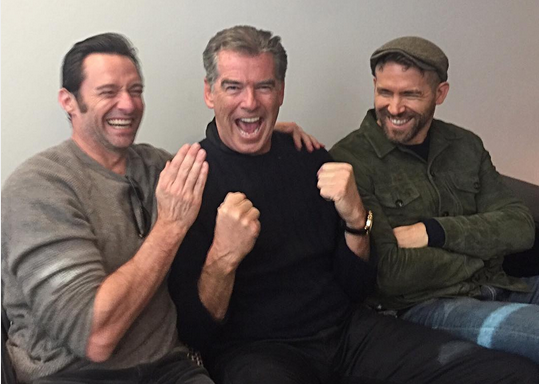 Just a bunch of manly men sitting around having fun as Jackman, left, Pierce Brosnan, center, and Ryan Reynolds yucked it up, noting that it was a