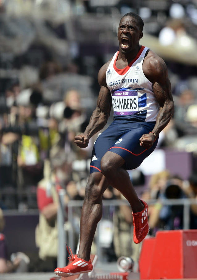 Britain's Dwain Chambers celebrates after finishing first in his men's 100m round 1 heats at the London 2012 Olympic Games at the Olympic Stadium August 4, 2012. REUTERS/Dylan Martinez (BRITAIN - Tags: OLYMPICS SPORT ATHLETICS TPX IMAGES OF THE DAY)