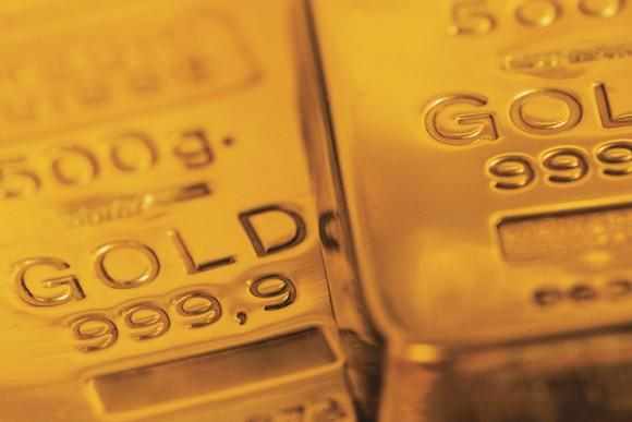 Two gold bars lying next to each other.