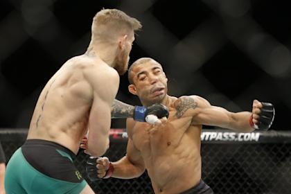 Conor McGregor knocks out Jose Aldo with a left hook at UFC 194. (AP)