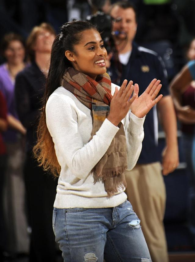 Former Notre Dame player Skylar Diggins reacts prior to the first half of an NCAA college basketball game Saturday, Nov. 16, 2013, in South Bend, Ind. Diggins was inducted into the Notre Dame Ring of Honor. (AP Photo/Joe Raymond)