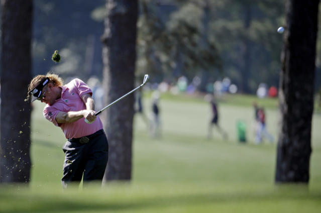 Miguel Angel Jimenez, of Spain, hits off the first fairway during the first round of the Masters golf tournament Thursday, April 10, 2014, in Augusta, Ga. (AP Photo/Darron Cummings)