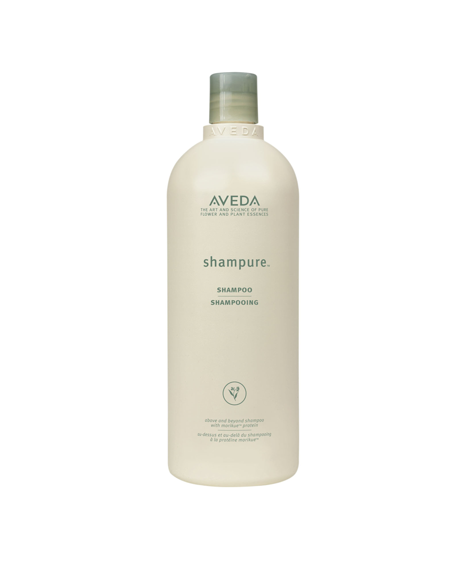 """<strong>Bulk Up</strong><br><br>For many of us, living in tiny apartments means buying in bulk is out. But Aveda offers a compelling reason to rethink that strategy, in the bathroom at least. The company notes that buying one of its liter-sized hair-care products — instead of five standard-size bottles — means consuming 40% less plastic (and a 25 cents/oz savings). As for the other 60% of that plastic consumed, the brand makes other moves to recoup waste. It uses post-consumer recycled material as much as it can and tries to package products in containers that can be recycled from home. If any brand product can't be picked up curbside (like makeup brushes), bring it into an Aveda store and pop it in its <a href=""""http://www.aveda.com/living-aveda/responsible-packaging"""" rel=""""nofollow noopener"""" target=""""_blank"""" data-ylk=""""slk:recycling bin"""" class=""""link rapid-noclick-resp"""">recycling bin</a>.<br><br><strong>Aveda</strong> Shampure Shampoo in 1 Liter Size, $, available at <a href=""""https://go.skimresources.com/?id=30283X879131&url=http%3A%2F%2Fwww.aveda.com%2Fproduct%2F5311%2F17037%2Fhair-care%2Fshampoo%2Fshampure-shampoo"""" rel=""""nofollow noopener"""" target=""""_blank"""" data-ylk=""""slk:Aveda"""" class=""""link rapid-noclick-resp"""">Aveda</a>"""