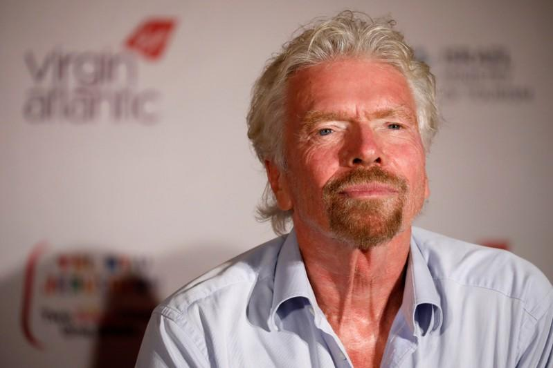 Virgin's Richard Branson attends a news conference after landing at the Ben Gurion international airport near Tel Aviv