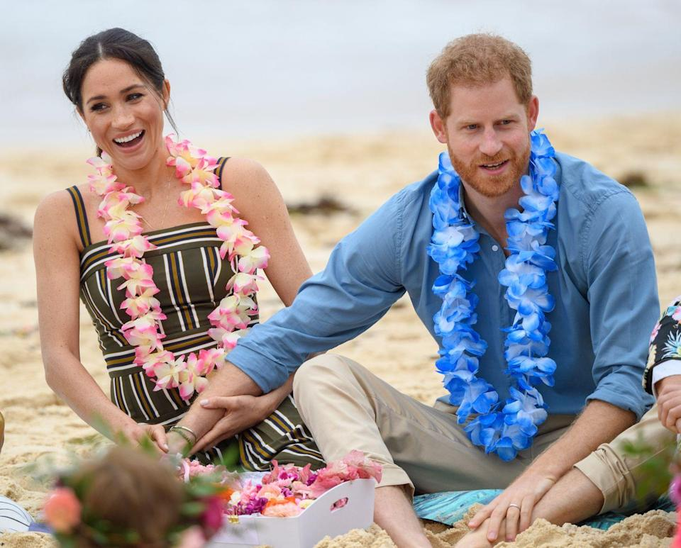 <p>And perhaps their sexiest and least royal instance of PDA was when Harry put his hand on Meghan's UPPER THIGH during an event at Bondi Beach, Australia. Are you sweating? I'm definitely sweating.</p>