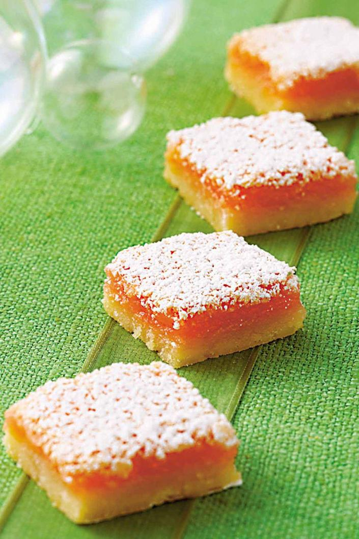 """<p>Sweet and tangy, these pink lemonade bars are sure to please with a buttery base that's layered with a soft, lemon-zest laced filling, and dusted with a thick coating of confectioners' sugar.</p><p><a href=""""https://www.womansday.com/food-recipes/food-drinks/recipes/a10543/pink-lemonade-bars-121785/"""" rel=""""nofollow noopener"""" target=""""_blank"""" data-ylk=""""slk:Get the recipe for Pink Lemonade Bars."""" class=""""link rapid-noclick-resp""""><u><em>Get the recipe for Pink Lemonade Bars.</em></u></a></p>"""
