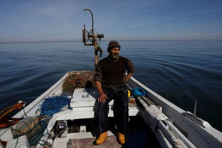 Fisherman Cengiz Topcu, 57, who says he will vote 'No' in the referendum, poses in his boat in Rize on the Black Sea coast, Turkey, April 5, 2017. REUTERS/Umit Bektas