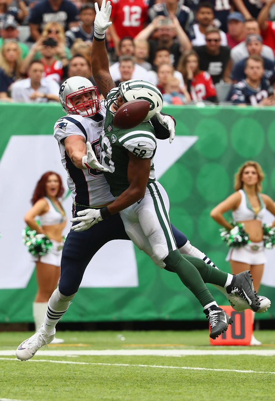 <p>Tight end Rob Gronkowski #87 of the New England Patriots attempts to make a catch around inside linebacker Darron Lee #58 of the New York Jets during the second quarter of their game at MetLife Stadium on October 15, 2017 in East Rutherford, New Jersey. (Photo by Al Bello/Getty Images) </p>