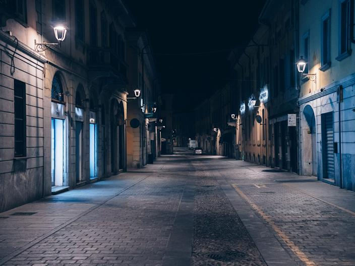 Life inside a red zone: An empty street at night is seen in San Fiorano, one of the towns on lockdown due to a coronavirus outbreak.