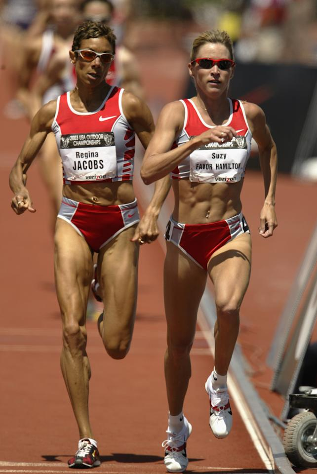 PALO ALTO, CA - JUNE 21: Suzy Favor Hamilton of Nike leads Regina Jacobs of Nike in the women's 1500m final at the USA Outdoor Track and Field Championships at Cobb Track and Angell Field at Stanford University on June 21, 2003 in Palo Alto, California. (Photo by Brian Bahr/Getty Images)
