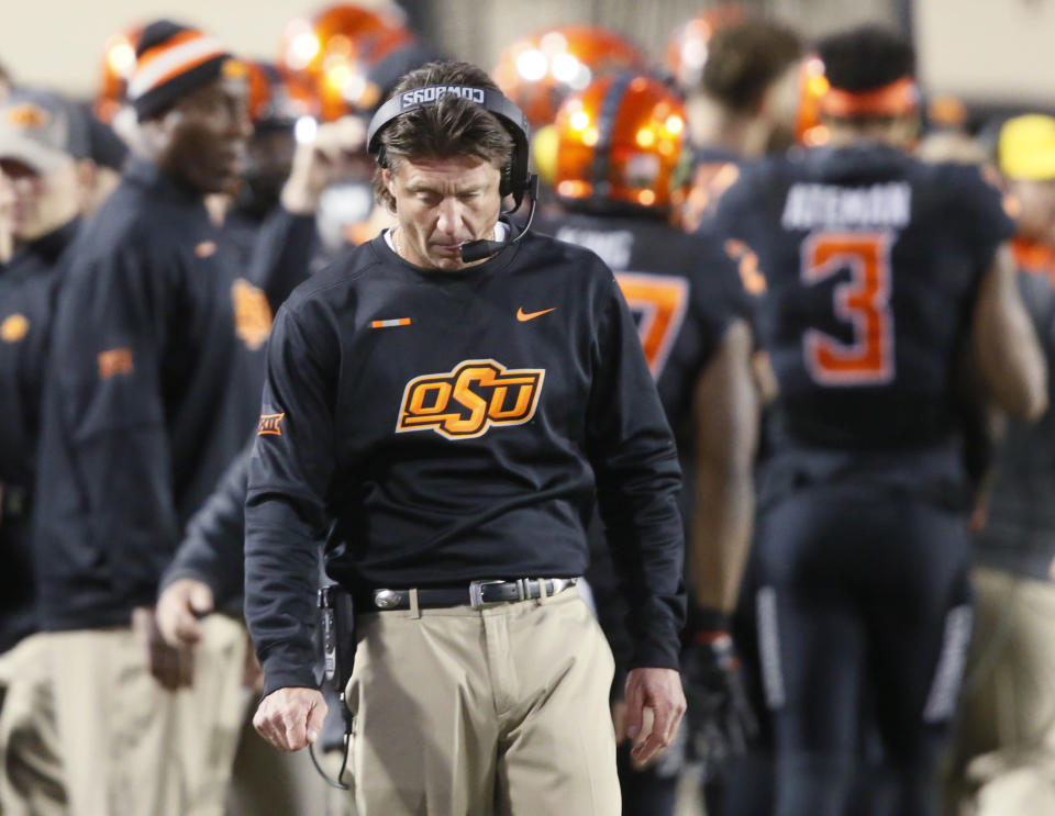 Oklahoma State head coach Mike Gundy walks on the sidelines in the second half of an NCAA college football game against Kansas State in Stillwater, Okla., Saturday, Nov. 18, 2017. Kansas State won 45-40.(AP Photo/Sue Ogrocki)