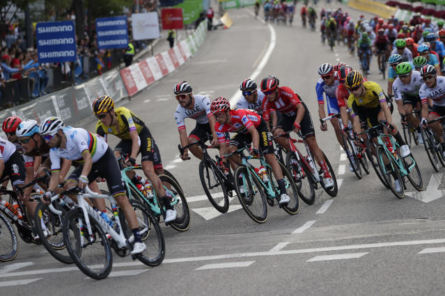 Race leader Primoz Roglic, centre, rides with the pack in the Spanish capital during the La Vuelta cycling race in Madrid, Spain, Sunday, Sept. 15, 2019. (AP Photo/Manu Fernandez)