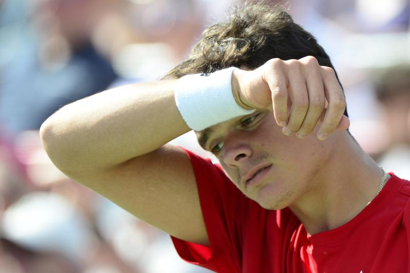 Milos Raonic, of Canada, reacts while playing against Rafael Nadal, of Spain, during men's Rogers Cup tennis tournament final action in Montreal, Sunday, Aug. 11, 2013. (AP Photo/The Canadian Press, Paul Chiasson)