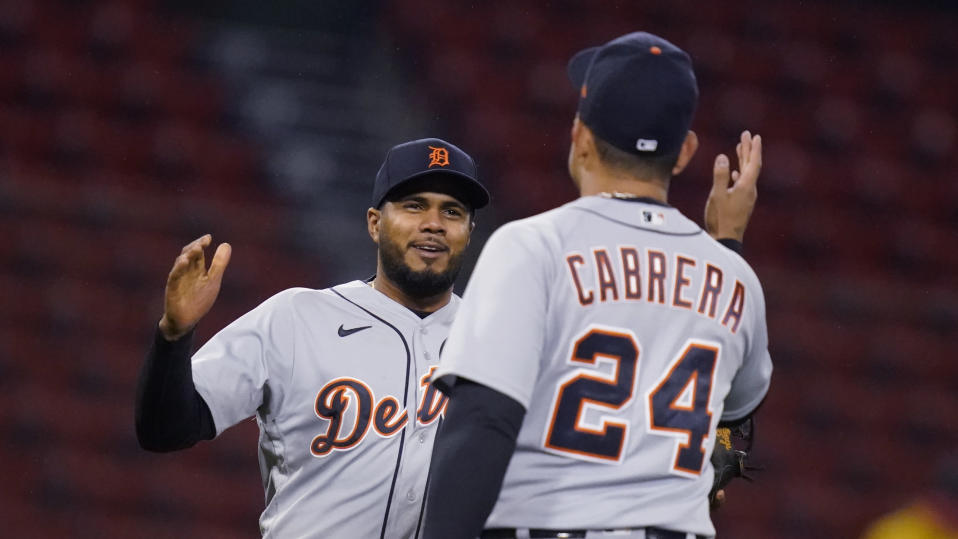 Detroit Tigers third baseman Jeimer Candelario, left, is congratulated by Miguel Cabrera (24) after the Tigers defeated the Boston Red Sox 6-5 in a baseball game at Fenway Park, Wednesday, May 5, 2021, in Boston. Candelario hit a three-run home run in the 10th inning. (AP Photo/Charles Krupa)