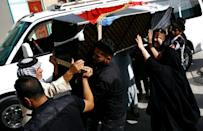 Iraqis carry the coffin of a victim of a car bombing in Sadr City, during a funeral in the holy city of Najaf, on May 11, 2016