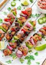 "<p>You'll want to build your entire dinner menu around these pretty kebabs. (Guacamole, salsa, sour cream - yum!)</p> <p><strong>Get the recipe:</strong> <a href=""http://www.wellplated.com/fajita-chicken-kebab-recipe/"" class=""link rapid-noclick-resp"" rel=""nofollow noopener"" target=""_blank"" data-ylk=""slk:fajita chicken kebabs"">fajita chicken kebabs</a></p>"