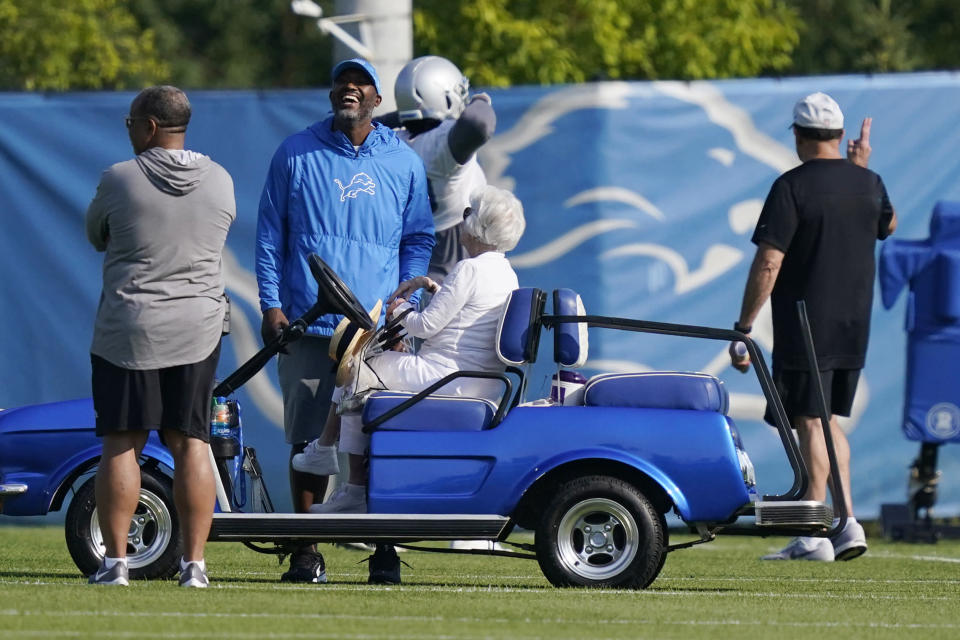 Detroit Lions General Manager Brad Holmes laughs as he talks with team Chair Emeritus/Owner Martha Firestone Ford during drills at the Lions NFL football camp practice, Wednesday, July 28, 2021, in Allen Park, Mich. (AP Photo/Carlos Osorio)
