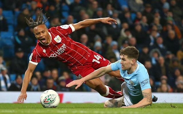 West Bromwich Albion have launched a £10m bid to sign Bristol City attacker Bobby Reid and Brentford's Romaine Sawyers as the club prepares for the Championship. Darren Moore, Albion's head coach, has offered around £7m for Reid and is hopeful of agreeing a fee with City this month. Reid scored 19 goals in the league last season and was a key figure as Lee Johnson reached the Carabao Cup semi-finals. Sawyers, a former West Brom academy graduate, is also high on Moore's list of targets with a £3m bid understood to be imminent. West Brom are determined to back Moore as they aim for a swift return to the Premier League. West Brom are preparing a £3m bid for their former academy player Romaine Sawyers (right) Credit: John Walton/PA Jonny Evans was the first departure last week, following relegation into the second tier, after completing a £3m move to Leicester. The futures of Jay Rodriguez, Salomon Rondon and Jake Livermore are also uncertain, with a number of top-flight clubs ready to test Albion's resolve. James McClean, the Republic of Ireland international, is a target for Stoke manager Gary Rowett. But Moore wants to keep the core of his squad together and Albion are poised to open talks with defender Craig Dawson over a new deal.