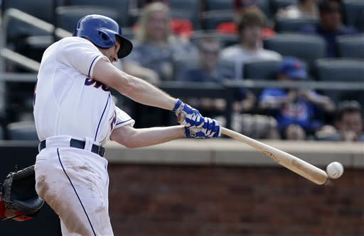 New York Mets' Daniel Murphy hits an RBI single during the seventh inning of a baseball game against the Philadelphia Phillies Saturday, July 20, 2013, in New York. (AP Photo/Frank Franklin II)