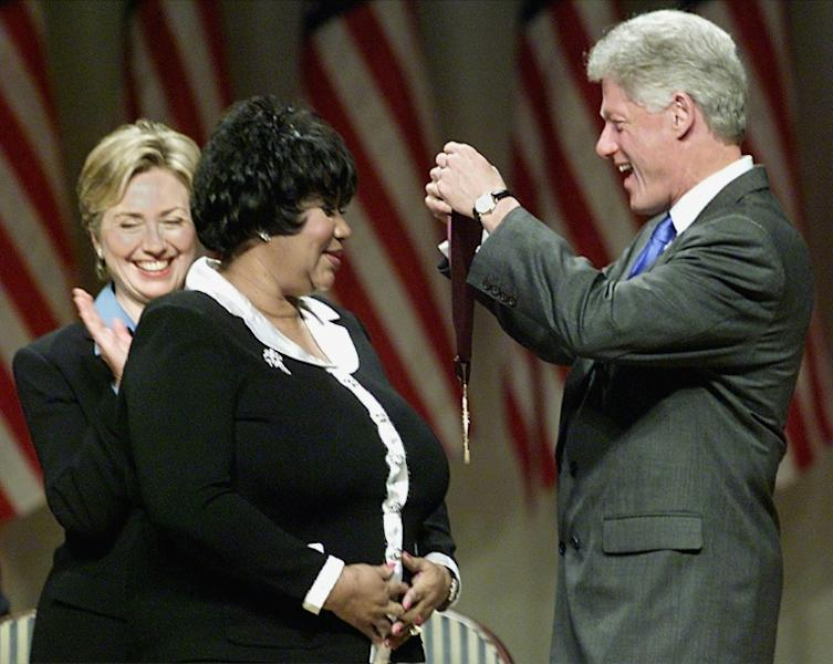 Items from the wardrobe of Aretha Franklin, pictured with then-US president Bill and former first lady Hillary in 1999, are to go on sale in New York