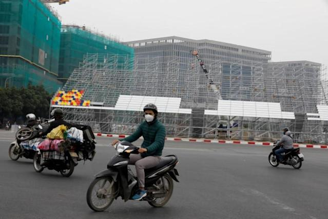 FILE PHOTO: Motorcyclists ride along the racing track of Formula One Vietnam Grand Prix in Hanoi