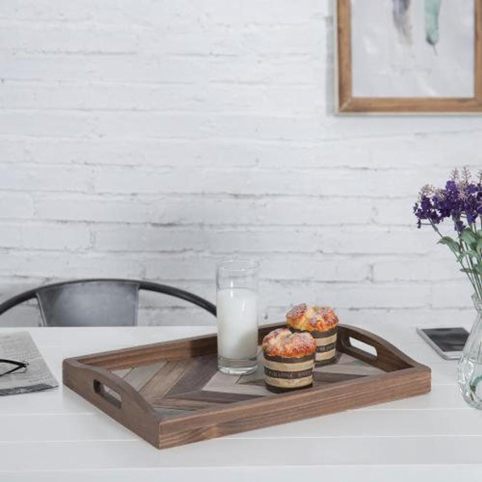 <p>This <span>Wood Serving Tray</span> ($31) will make sure they're served breakfast in style.</p>