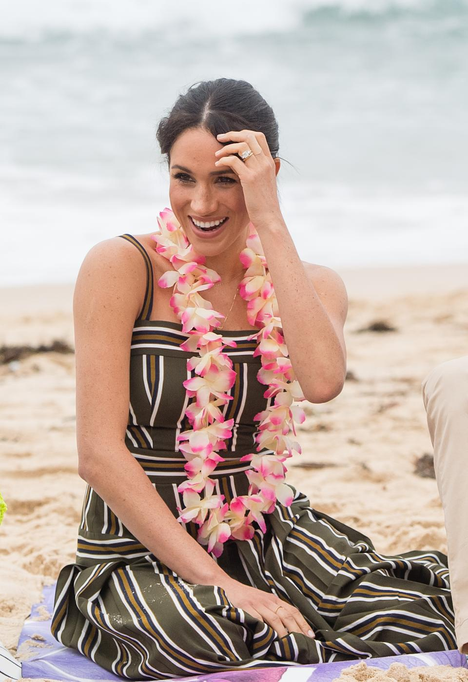 Meghan wears a striped Martin Grant maxi dress on a visit to Bondi Beach in 2018 [Photo via Getty Images]