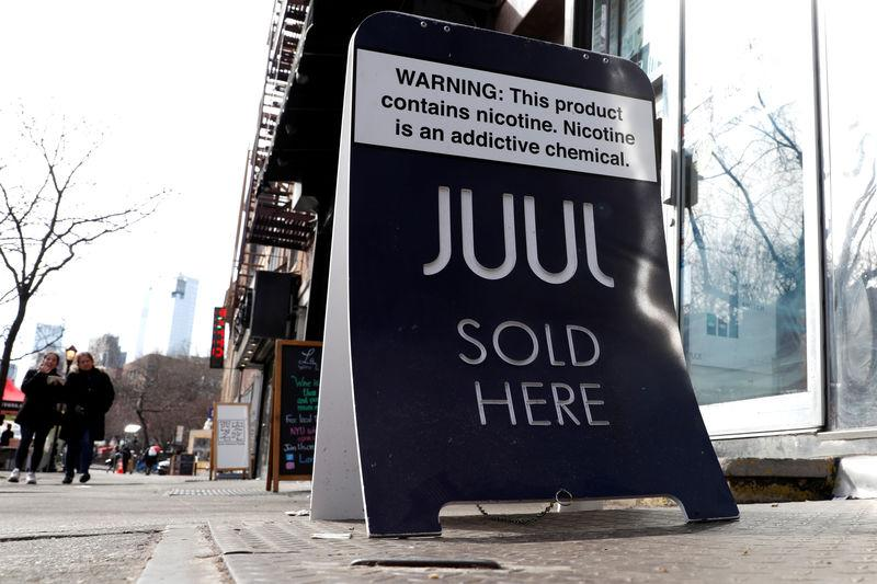 A sign advertising Juul brand vaping products is seen outside a shop in Manhattan in New York City