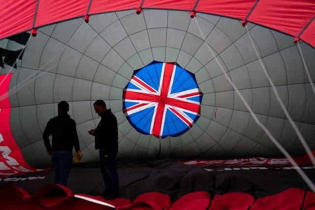 A balloon is inflated prior to its flight (Jacob King/PA)