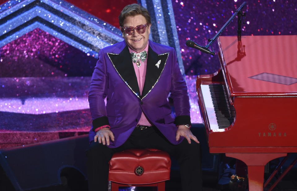 """Elton John is seen after performing """"(I'm Gonna) Love Me Again"""" nominated for the award for best original song from """"Rocketman"""" at the Oscars on Sunday, Feb. 9, 2020, at the Dolby Theatre in Los Angeles. (AP Photo/Chris Pizzello)"""