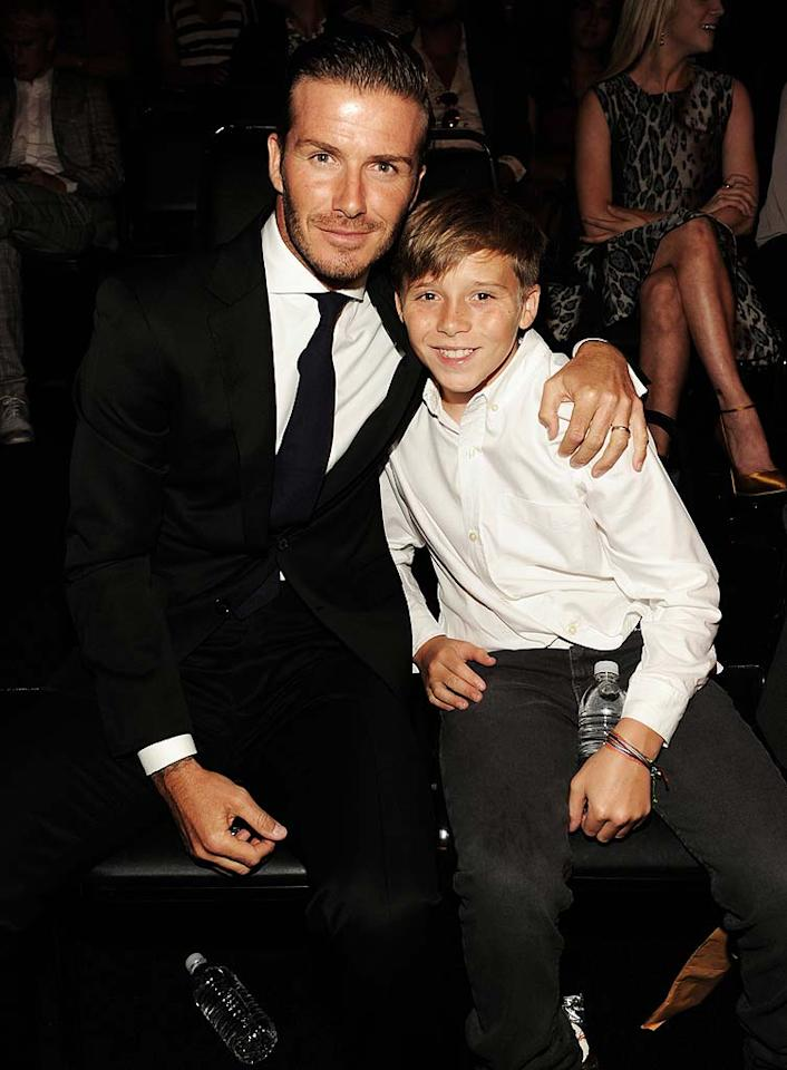 """Dad of four David Beckham got in some one-on-one time with his eldest son, 12-year-old Brooklyn, by making him his pint-size date for the show. Becks took home the Do Something Athletes award in recognition of his donations to various causes. Kevin Mazur/<a href=""""http://www.wireimage.com"""" target=""""new"""">WireImage.com</a> - August 14, 2011"""