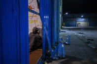 Two minors sleep inside a warehouse turned into a makeshift center for migrant minors at the Spanish enclave of Ceuta, at the border of Morocco and Spain, early Wednesday, May 19, 2021. (AP Photo/Bernat Armangue)