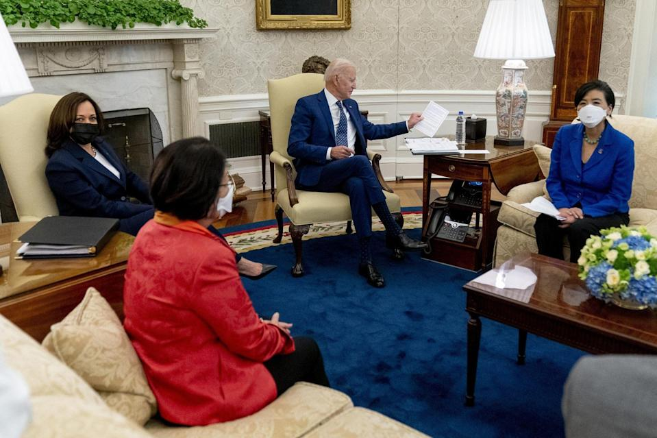 US President Joe Biden and Vice-President Kamala Harris meet with Senator Mazie Hirono (foreground), Representative Judy Chu (right) and other members of the Congressional Asian Pacific American Caucus Executive Committee in the Oval Office on April 15. Photo: AP