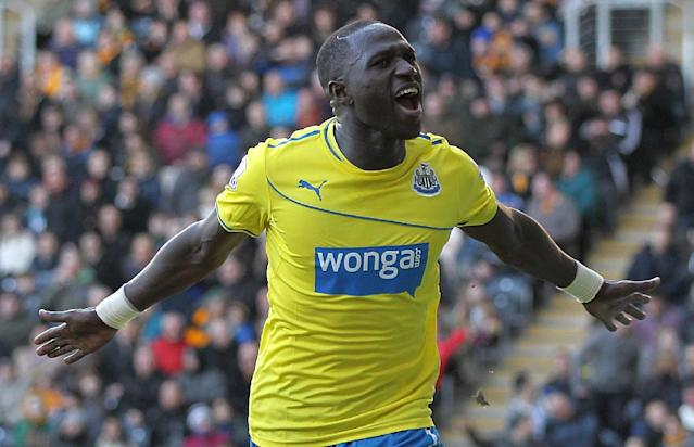 Newcastle United's Moussa Sissoko, celebrates scoring his second goal of the game against Hull during the English Premier League match at the KC Stadium, Hull England Saturday March 1, 2014. (AP Photo/Lynne Cameron/PA)