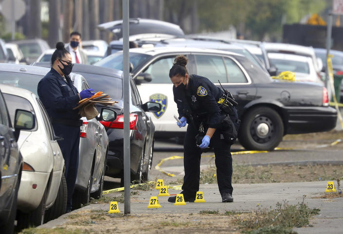 Image: Oakland police officers investigate a shooting with a police officer at a marijuana business (Aric Crabb / Bay Area News via AP file)