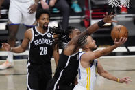 Brooklyn Nets guard Spencer Dinwiddie (26) watchs as Nets center DeAndre Jordan (6) defends Golden State Warriors guard Stephen Curry (30) during the first quarter of an opening night NBA basketball game, Tuesday, Dec. 22, 2020, in New York. (AP Photo/Kathy Willens)