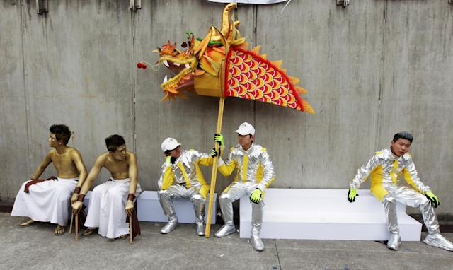 SHANGHAI, CHINA - APRIL 15: Local dance troupe prepare to perform before the start of the Chinese Formula One Grand Prix at the Shanghai International Circuit on April 15, 2012 in Shanghai, China. (Photo by Mark Thompson/Getty Images)