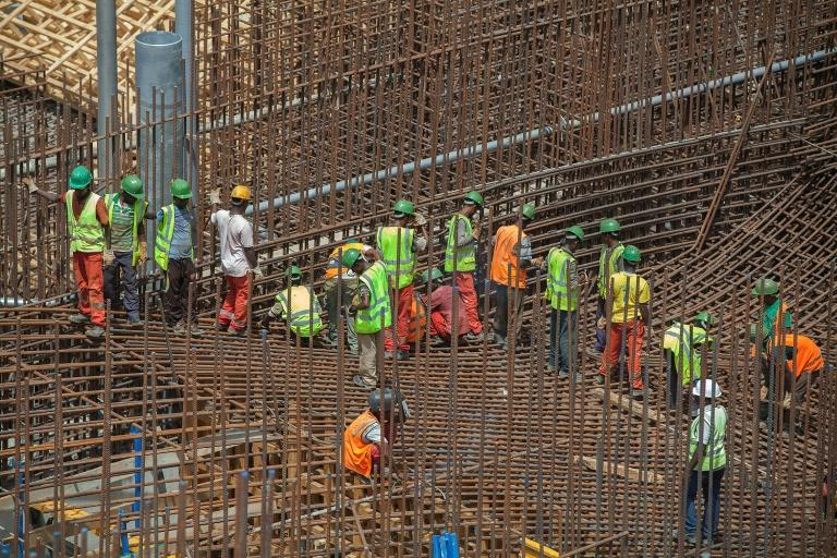 Ethiopian workers stand on scaffolding in 2015 during the construction of the Grand Renaissance Dam (AFP Photo/ZACHARIAS ABUBEKER)