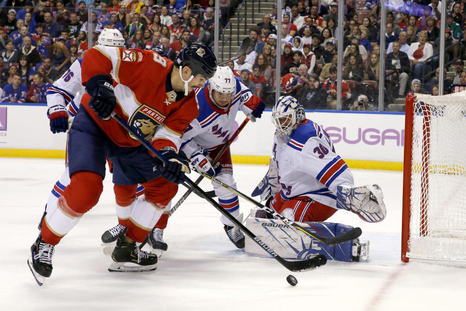 Florida Panthers center Brian Boyle (9) fails to score as New York Rangers goaltender Henrik Lundqvist (30) defends in the first period of an NHL hockey game, Saturday, Nov. 16, 2019, in Sunrise, Fla. (AP Photo/Joe Skipper)