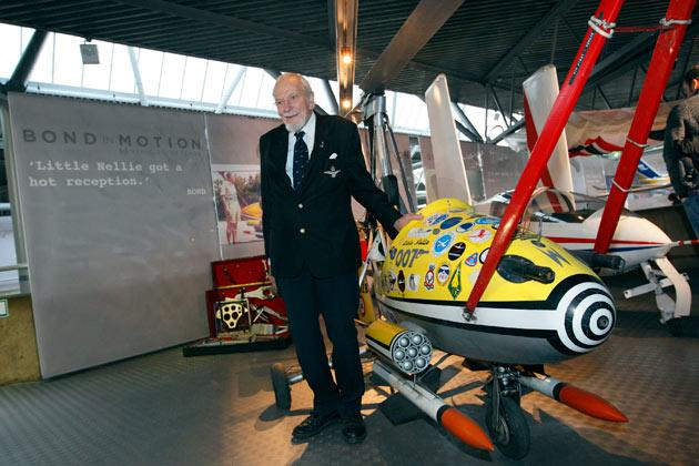 Kenneth Wallis poses for photographers with his invention, Little Nellie, at the opening of a press preview of the Bond in Motion exhibition at the Beaulieu National Motor Museum at Brockenhurst in the southern English county of Hampshire on January 15, 2012. The Bond in Motion exhbition features fifty original iconic vehicles used in the James Bond films to celebrate fifty years of 007 and will open to the public from January 17. AFP PHOTO/ JUSTIN TALLIS
