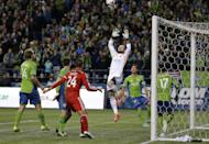 Seattle Sounders goalkeeper Stefan Frei leaps for a shot from FC Dallas in the first half of an MLS western conference semifinal soccer match, Monday, Nov. 10, 2014, in Seattle. (AP Photo/Ted S. Warren)