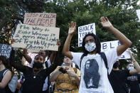 Demonstrators hold up their hands during a rally in Sacramento, Calif., Tuesday, June 2, 2020, protesting the death of George Floyd. Floyd died May 25 after being restrained by Minneapolis police. (AP Photo/Rich Pedroncelli)