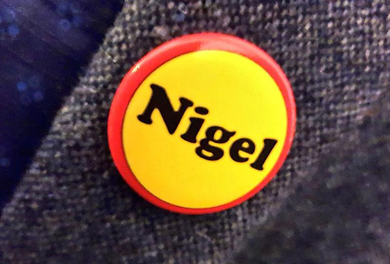 "A ""Nigel"" badge on display at the event (Picture: PA)"