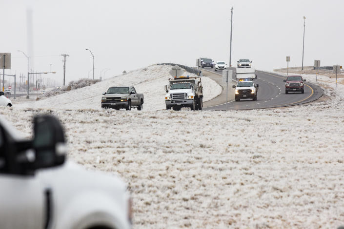 Motorist drive east on Texas State Highway 191 headed towards Midland from Odessa Friday, Feb. 12, 2021, in Midland County, Texas. Friday is the second day the Permian Basin has seen freezing weather as a Winter Weather Advisory issued by the National Weather Service for the region remains in effect until 11 a.m. Saturday. The NWS forecasts that the cold temperatures will remain in the Basin throughout the weekend with Sunday night seeing a 70% chance of snow. (AP Photo|Odessa American, Jacob Ford)/Odessa American via AP)