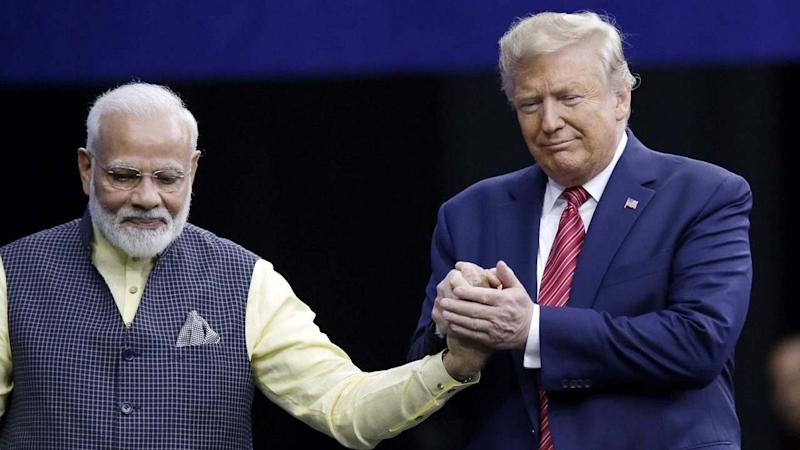 """Houston: Prime Minister Narendra Modi and President Donald Trump shake hands after introductions during the """"Howdi Modi"""" event Sunday, Sept. 22, 2019, at NRG Stadium in Houston. AP/PTI Photo(AP9_23_2019_000007B)"""