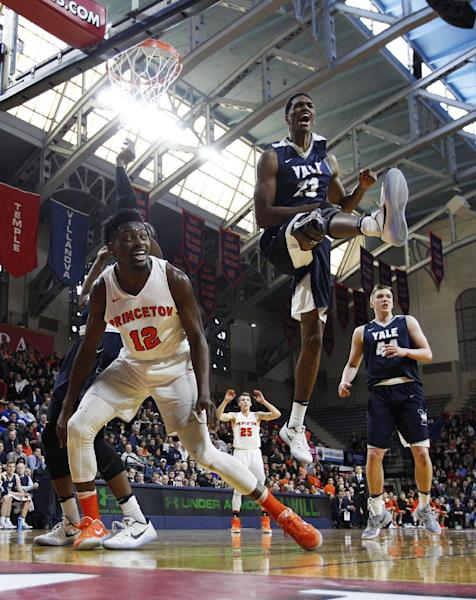Yale's Jordan Bruner, right, reacts to blocking the shot by Princeton's Myles Stephens, left, during the first half of an NCAA college basketball championship game in the Ivy League Tournament, Sunday, March 12, 2017, in Philadelphia. (AP Photo/Chris Szagola)