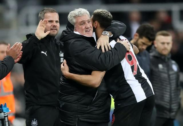 Newcastle boss Steve Bruce celebrates a goal with his striker Joelinton (Owen Humphreys/PA)