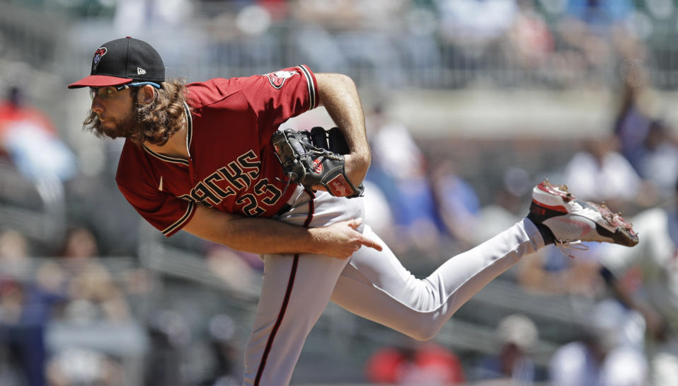 Arizona Diamondbacks pitcher Zac Gallen works against the Atlanta Braves in the first inning of the first baseball game of a double header, Sunday, April 25, 2021, in Atlanta. (AP Photo/Ben Margot)