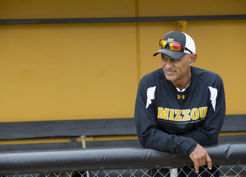 ADDS THIRD SENTENCE - In this photo taken May 19, 2011, Missouri assistant softball coach Phil Bradley watches his players warmup before practice on the softball field in Columbia, Mo. The Tigers host DePaul, Indiana and Illinois State this weekend at a double-elimination NCAA Regional. Bradley is serving as a volunteer assistant coach. (AP Photo/L.G. Patterson)