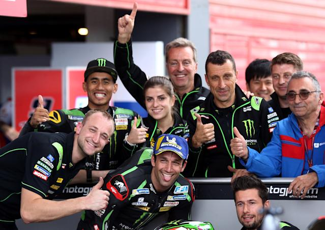 Motorcycle Racing - Argentina Motorcycle Grand Prix - MotoGP Qualifying Session - Termas de Rio Hondo, Argentina - April 7, 2018 - Monster Yamaha Tech 3 rider Johann Zarco of France sticks his tongue out as he poses with members of his team at the end of the qualifying session. REUTERS/Marcos Brindicci